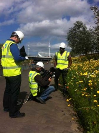 This is my co-presenter Ore and the crew filming in Olympic Park with their safety gear on