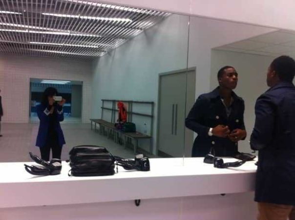 Ore checking his make up in the Aquatics Centre changing rooms