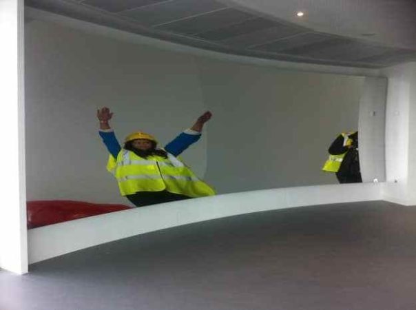 We were invited to film inside the Orbit in Olympic Park before it opened. The viewing gallery has two huge mirrors in it