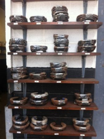 I spotted these horseshoe shelves while filming at three day eventer William Fox-Pitt's stables