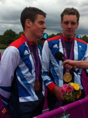 I took this photo after the triathlon medal ceremony. Jonny wasn't feeling great but still did all his media interviews.