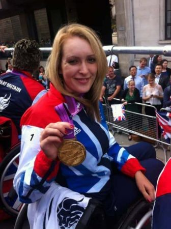 The Paralympic archer showed off her gold medal during the parade