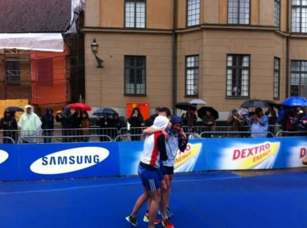 Britain defending their title. This is Vicky Holland and Non Stanford hugging teammate Jonny Brownlee as he came over the line